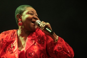 Calypso Rose sings into the microphone